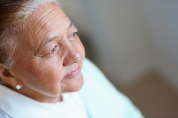 Worried old woman looking away thinking