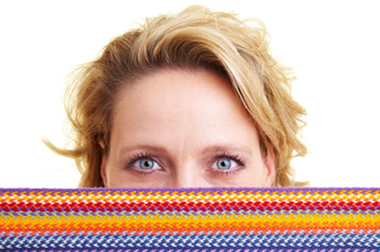 Woman hiding behind scarf
