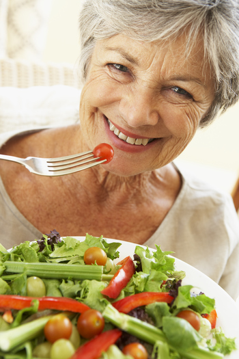 Senior Woman Eating Healthy Salad